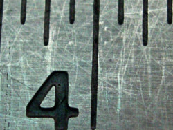 Close-up of a ruler showing the number four.